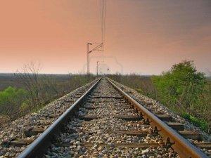 straight-train-tracks-with-dark-sky-above